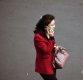 [포토] 휴대전화로 통화하며 걷는 북한 여성