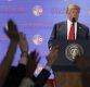 트럼프, 김정은에 아이패드로 '핵 포기한 북한 미래상' 보여줘