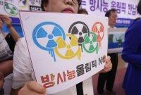 무더위에 방사능 폐기물 유실까지…도쿄올림픽 총체적 난국